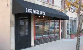 Rigid Storefront Awning with Winter Door Curtain